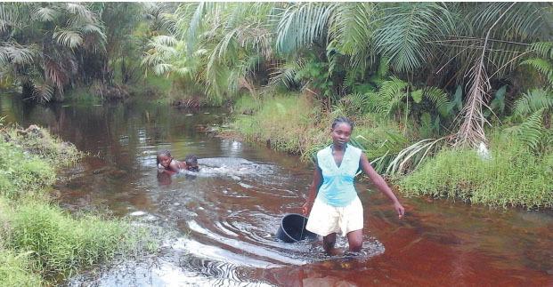 liberian girls often haul buckets of water from rivers long distances away