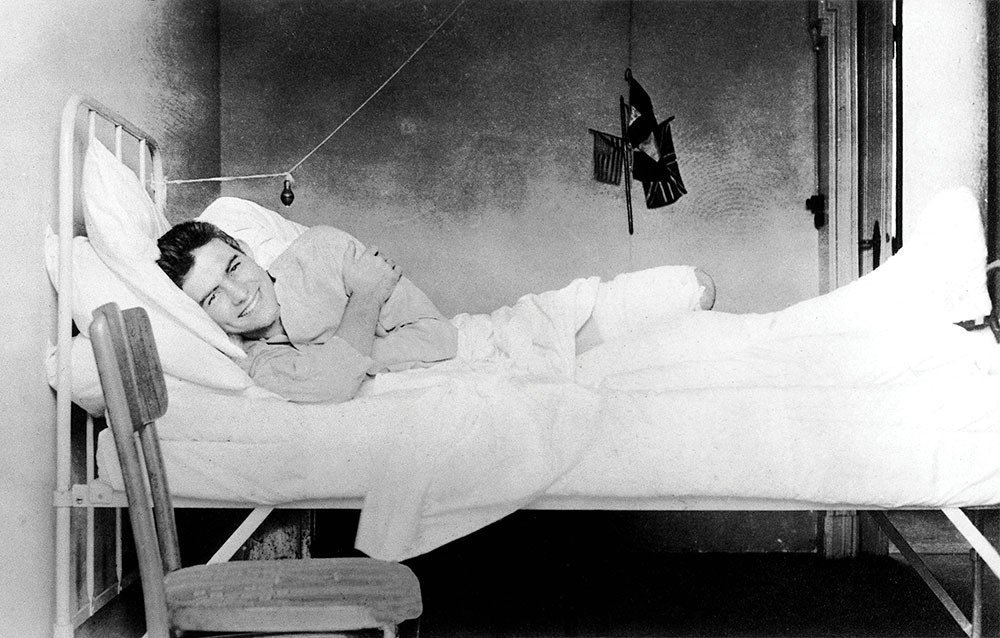ernest hemingway in a bed recovering from wounds
