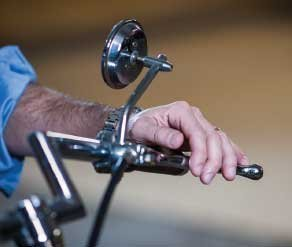 hand on bike handlebar